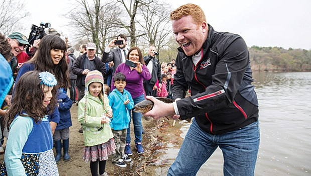 City Councilor Matt O'Malley joined Governor Charlie Baker, state officials and students from Mary Curley Elementary and Middle School to help the Division of Fisheries and Wildlife stock Jamaica Pond in Boston with trout.
