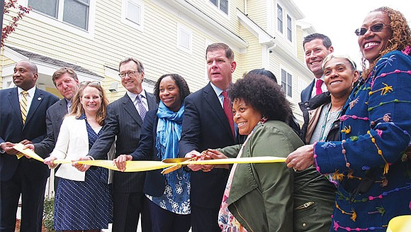 Mayor Martin Walsh joined neighborhood activists to cut the ribbon on 44 new units of affordable housing in the Codman ...