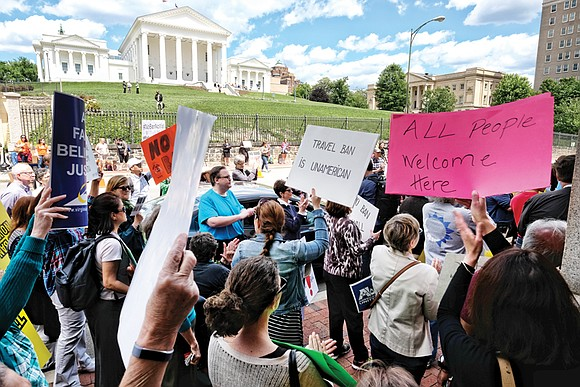 The challenge to President Trump's revised travel ban moved to Richmond on Monday, where nearly 200 protesters opposed to the ...