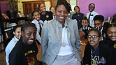Lovely Hoffman, a middle school teacher at the Helen Y. Davis Leadership Academy in Dorchester, center, poses with some of the students when worked with in Boston on Mar. 13, 2017. (Suzanne Kreiter/The Boston Globe via Getty Images. Courtesy of The Undefeated)