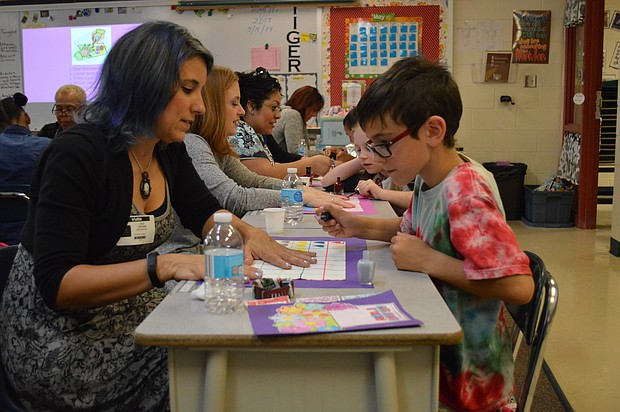 Students treated their moms to a spa day at Plainfield's River View Elementary--a day which included manicures.