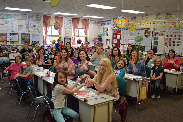 Students and their moms show off their manicures in Mrs. Rodriguez's class at River View Elementary in Plainfield.