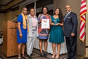 NAACP Secretary, Beverly Jones-Wright alongside Honoree Odessa Brag's daughters