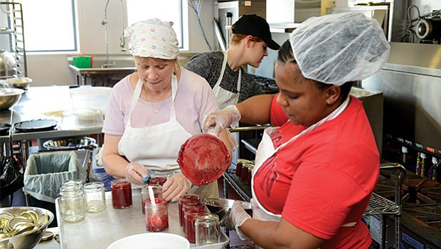 The team at Deborah's kitchen makes jam.