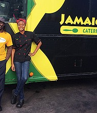 The Jamaica Mi Hungry team with their mobile kitchen.
