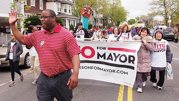 District 7 City Councilor Tito Jackson campaigning for mayor in the Jamaica Plain Wake Up the Earth parade.