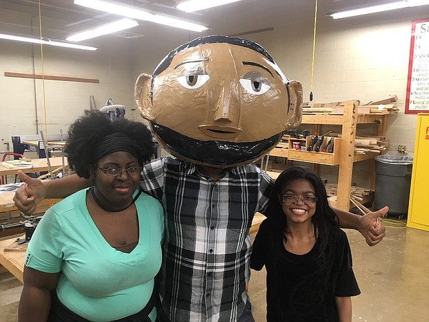Patrice Wilson (left) and Sharday Hawkins from the Memphis College of Art helped create the head of Odd Wilson. Jabriel Woodall is the graphic designer who applied his skills to bringing Odd Wilson to life.