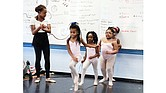 Briana Brown, an instructor with New Ballet Ensemble, prepares her first-grade dance students for a performance at Dunbar Elementary School in Memphis. (Photo: Caroline Bauman)