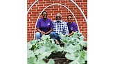 From left, Francine McNair, lead gardener at Eden's Community Garden at Second Baptist Church of South Richmond, Marc A. Jolley, garden adviser, and Deion Coleman, garden director, pause for a moment by the broccoli plants. The garden employs a cistern and water filtration system that uses runoff from the church parking lot.