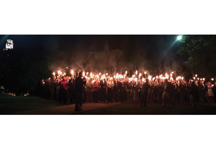Protests reminiscent of Ku Klux Klan rallies are rattling Charlottesville over the city's plans to remove a statue of Confederate