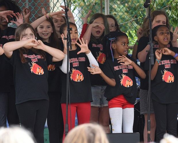 Strawberry Street Festival // Youngsters from Richmond's William Fox Elementary School perform during the 38th Annual Strawberry Street Festival last Saturday. The event featured games, rides, raffles, auctions and, of course, strawberries. Proceeds from the festival benefit the school.