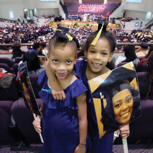 Future grads // Twins Cydney and Camryn Hamlin, 6, of Philadelphia are ready and waiting to see big sister Tyler Stafford get her degree at Virginia Union University's commencement last Saturday at St. Paul's Baptist Church. The duo led Ms. Stafford's cheering section. Please see area commencement coverage and photos, B2 and B3.