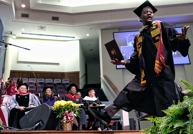 Marquis Johnson of Newport News is elated to get his degree in mass communications from Virginia Union University during Saturday's ceremony at St. Paul's Baptist Church in Henrico.