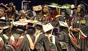 A group of students stand and turn their backs during a commencement exercise speech by United States Secretary of Education Betsy DeVos at Bethune-Cookman University, May 10, in Daytona Beach, Florida.