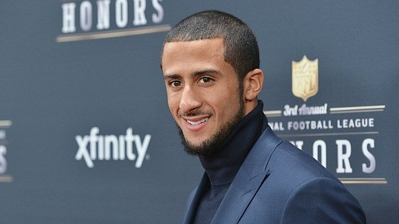 As Colin Kaepernick made his way to the podium, a surprised crowd broke into thunderous applause.