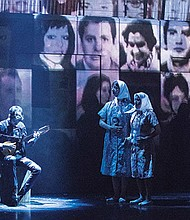 The many faces of Argentina's Disappeared projected behind the ensemble portraying mothers, desperate to find their missing children.
