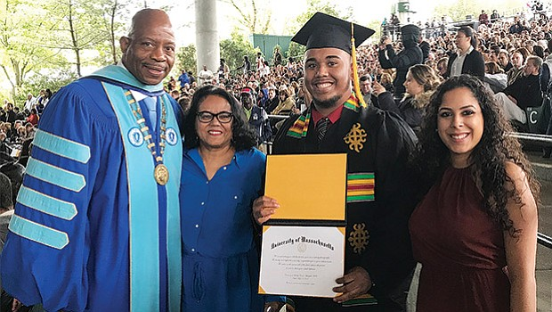 UMass Boston Chancellor Keith Motley attended the graduation ceremony at UMass Dartmouth to bestow a bachelor's degree in political science to his mentee Bruce C. Bolling Jr. His mother Joyce Ferriabough Bolling and friend Amanda Ruiz beam with pride.