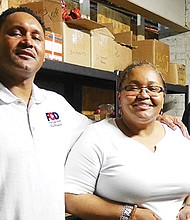 Ronnette Taylor-Lawrence, owner of Fire Code Design, with sons Anthony (l), who serves as FCD's director of business development, and Julian, an apprentice sprinkler fitter and assistant project manager with FCD.