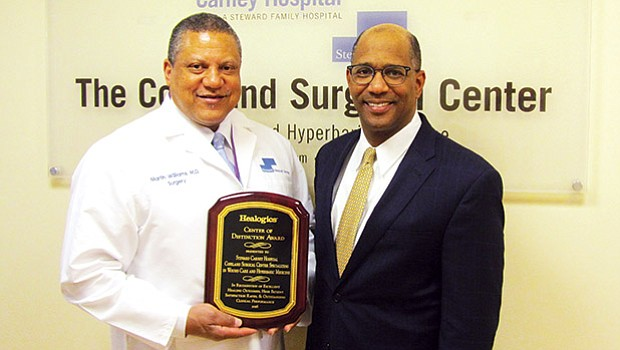 Carney Hospital CEO Walter Ramos and Dr. Martin Williams received a Center of Distinction Award from Healogics, the nation's leading wound care management company, awarded to the Copeland Surgical Center. The Copeland Surgical Center achieved outstanding clinical outcomes for 12 consecutive months, including patient satisfaction higher than 92 percent and a wound healing rate of at least 91 percent in less than 31 median days. Out of 630 Centers eligible for the Center of Distinction award, 334 achieved this honor in 2017.