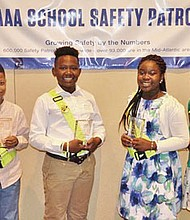 Four Baltimore County Safety Patrollers were honored on May 10, 2017 by AAA Mid-Atlantic Foundation. (Above, left to right) Sharshalam Scott, Randallstown Elementary School; Jamir Lawson, Dogwood Elementary School (Windsor Mill); and Catonsville students, Ivana Awuah, Westowne Elementary School; and Jataye Thomas; Woodbridge Elementary School.