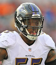 Ravens OLB Terrell Suggs looks into the huddle before a play during the final game of the 2016 NFL season against the Cincinnati Bengals.