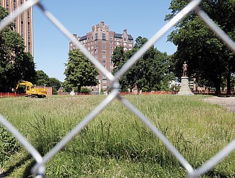 Behind construction fencing, part of Monroe Park appears untouched. But heavy equipment is digging up ground elsewhere on the 7.3-acre site. The city's oldest park has been closed to the public since November to make way for $6.6 million in improvements. Work began in April and could take 18 months to complete.