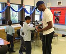 Students at Deneen School of Excellence gear up for an after-school boxing lesson.