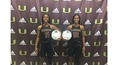 McNeill twins, left, Shareka, No.11, and Shameka, No.12, sign with the VUU Panthers.