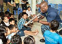 Da Nang, Vietnam— Musician 1st Class Vince Moody, from Severn, Maryland, of the U.S. 7th Fleet Band, Far East Edition, plays trumpet with local children at the Center for Agent Orange Victims Branch 3 Hoà Nhơn Ward during Pacific Partnership 2017 Da Nang May 11, 2017. Pacific Partnership is the largest annual multilateral humanitarian assistance and disaster relief preparedness mission conducted in the Indo-Asia-Pacific and aims to enhance regional coordination in areas such as medical readiness and preparedness for manmade and natural disasters.