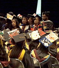 A group of students stand and turn their backs during a commencement exercise speech by United States Secretary of Education Betsy DeVos at Bethune-Cookman University, Wednesday, May 10, 2017, in Daytona Beach, Fla.