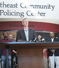 Portland Mayor Ted Wheeler speaks at a news conference attended by Oregon Gov. Brown and other community leaders after a man fatally stabbed two other men Friday on a light-rail train when they tried to stop him from yelling anti-Muslim slurs at two young women, one of whom was wearing a hijab. Jeremy Joseph Christian, 35, of Portland was arrested for aggravated murder and attempted murder in the attack.  (AP Photo)