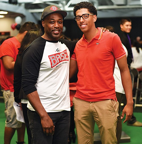 BASE Staff member Thomas Patterson, Jr. with Boston English Graduating Senior Allen Mejia, who will attend New Mexico Junior College in the fall.