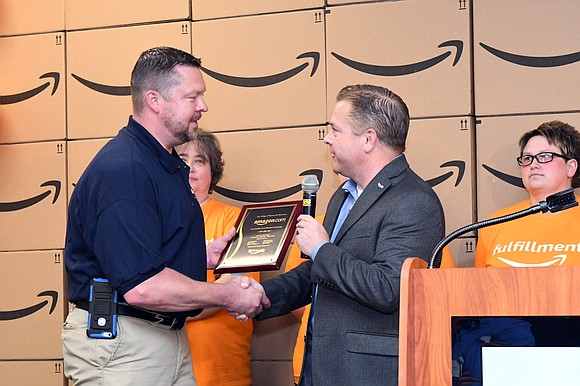 A 750,000 square foot Amazon.com fulfillment center that opened in Romeoville in September 2016, held its official grand opening on ...