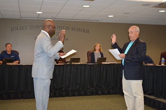Frank Edmon Jr. took the oath of office recently to become a Joliet Township High School Board of Education member.