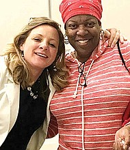 """Life Matters Media President Randi Belisomo [pictured left] celebrates with a participant [pictured right] in a """"Starting the Conversation""""program at Avalon Library."""