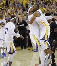 The Golden State Warriors celebrate after beating the Cleveland Cavaliers in Game 5 of basketball's NBA Finals in Oakland, Calif., Monday. The Warriors won 129-120 to win the NBA championship.