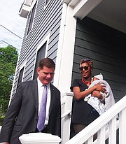 Mayor Martin Walsh tours Renee Omolade's newly-built Trull Street home in Dorchester.
