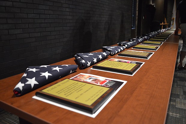 Plaques and flags honoring 20 area soldiers who died in service to their country on display at Joliet City Hall on Flag Day.