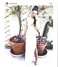 Ming Simmons in a prom gown designed by Kimora Lee Simmons