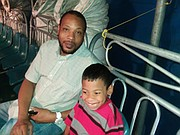 Rodney Lindsey and son Stephen, age 6, enjoy UniverSOUL circus experience.