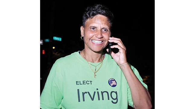 Antionette Irving steps outside her election party Tuesday night to call her mother and share the news that she won the Democratic primary for Richmond sheriff. Her watch party at Cary 100 Restaurant & Lounge in Downtown turned into a victory party.