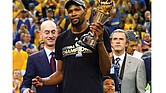 Kevin Durant of the Golden State Warriors celebrates after winning the MVP Award on Monday after Game 5 of the NBA finals at Oracle Arena in Oakland, Calif.