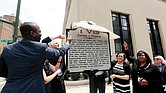From left, Richmond Mayor Levar M. Stoney, Gov. Terry McAuliffe, Sen. Jennifer L. McClellan, Sen. Rosalyn R. Dance and ACLU of Virginia Executive Director Claire Guthrie Gastañaga help unveil the new state marker outside the Patrick Henry Building at 11th and Broad streets.