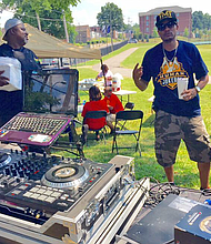 Michael McLaughlin enjoys the weather and company of others at last Saturday's HBCU Reunion Weekend cookout/block party on the campus of The LeMoyne-Owen College. (Courtesy photo)