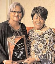 Gladys Piper (L), State Treasurer's Office, accepts her Leadership Award from Dr. Mildred C. Harris, founder and CEO, God First Church and Ministries, at the Annual Community Prayer Breakfast, held recently at the Chicago Hilton. For three decades, the Prayer Breakfast has been bringing together communities and leaders in government, education, business and religion to pray for the city, celebrate its people and accomplishments, provide financial scholarships and recognize individuals for their work improving neighborhoods.
