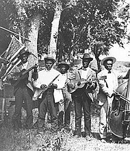 Musicians at a Juneteenth celebration in Eastwoods Park, Austin, Texas, circa 1900.