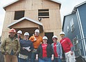 Volunteers from Wells Fargo work with Habitat for Humanity on its Helensview build site where 21 homes that are affordable to the community are being built in the Cully neighborhood of northeast Portland.