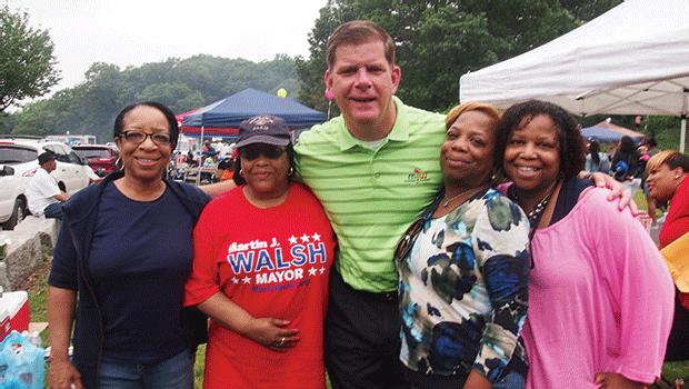 Diane Teal, Barbara Teal, Peachy White and Janet Teal enjoy a moment with Mayor Martin Walsh during Roxbury Homecoming in Franklin Park.