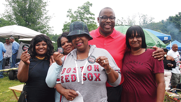 Gaynell McGee, Norma McGee, Kathy Nelson and Gina White enjoy a moment with City Councilor Tito Jackson.
