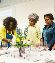 Participants in our event planning course learn the art of table setting and design.